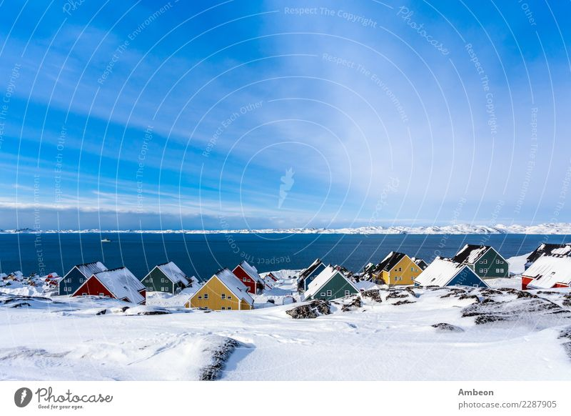Yellow, blue, red and green inuit houses covered in snow Sky Nature Vacation & Travel Town Colour Water White Landscape Ocean House (Residential Structure)