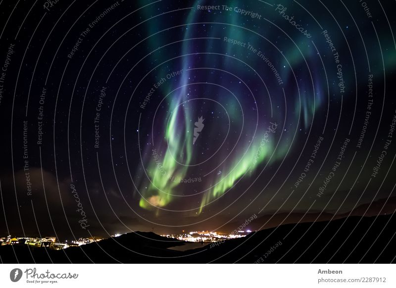 Glows of Northern Lights with shining stars on the sky Exotic Vacation & Travel Winter Snow Winter vacation Mountain Nature Landscape Air Sky Clouds Night sky