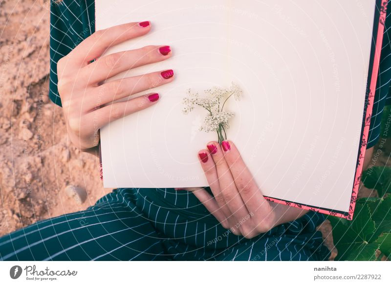 Woman's hands holding a book Human being Nature Youth (Young adults) Plant Flower 18 - 30 years Adults Feminine Art Moody Design Leisure and hobbies Elegant