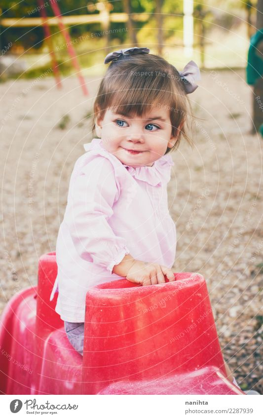 Lovely little girl in a park Child Human being Beautiful Joy Girl Lifestyle Feminine Style Leisure and hobbies Park Infancy Fresh Smiling Happiness Baby Cute