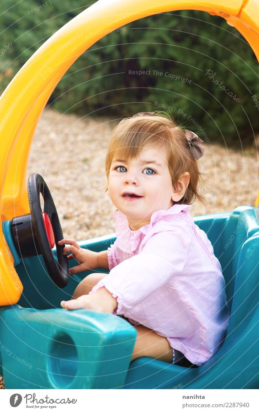 Happy little girl playing with a toy car Human being Nature Joy Girl Lifestyle Funny Feminine Playing Fashion Park Car Infancy Blonde Smiling Happiness To enjoy