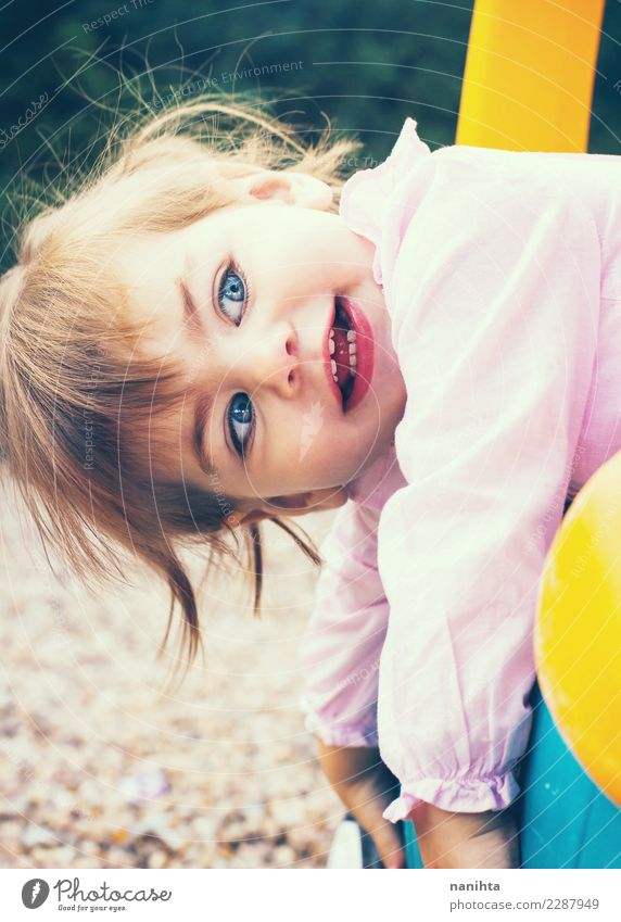 Beautiful and playful little girl Child Human being Joy Girl Lifestyle Funny Feminine Style Playing Leisure and hobbies Infancy Blonde Happiness To enjoy
