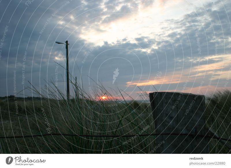 Sun Ocean Clouds Dark Meadow Grass Lighting Hill Fence Beach dune Electricity pylon