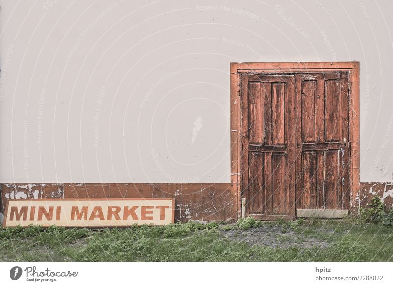 Mini Market Subculture Wall (barrier) Wall (building) Door Wood Signage Warning sign Graffiti Old Historic Broken Brown Gray Curiosity Concern Fatigue Longing
