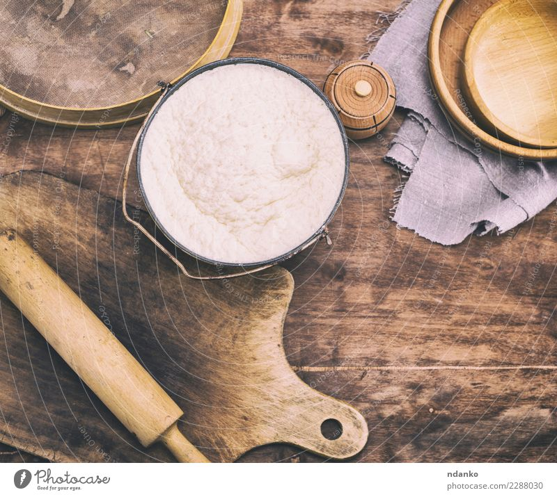 yeast dough made from wheat flour Dough Baked goods Bread Bowl Spoon Table Kitchen Wood Fresh Natural Above Brown White Yeast background Preparation food