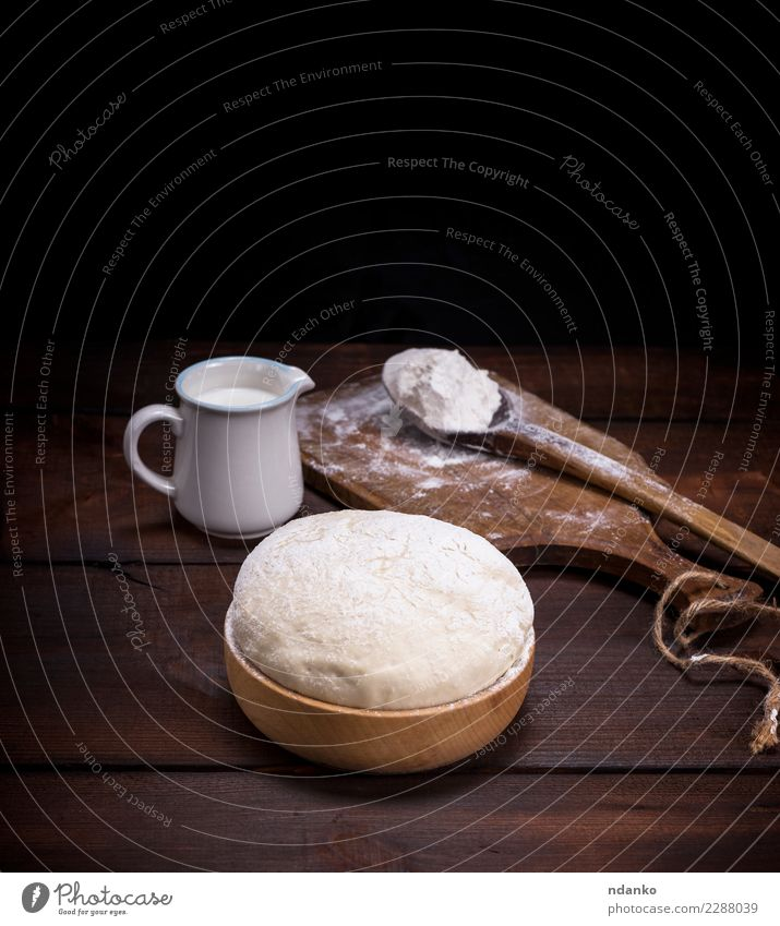 wheat yeast dough in a wooden bowl Food Dough Baked goods Bread Milk Bowl Spoon Table Kitchen Wood Eating Fresh Natural Above Brown White Yeast background