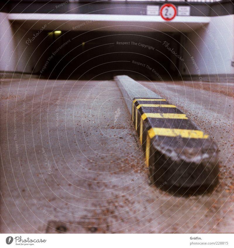 Black Yellow Street Dark Gray Signs and labeling Concrete Asphalt Warning label Parking garage Highway ramp (entrance) Underground garage Marker line