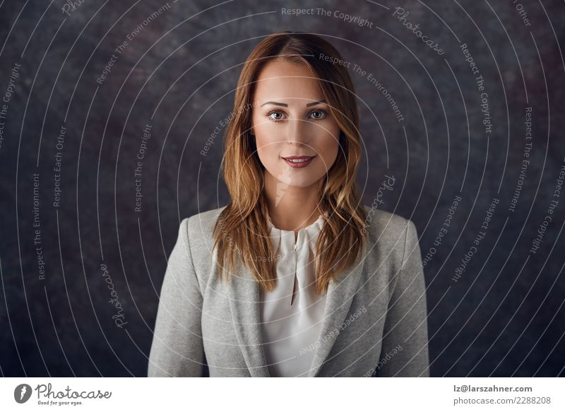 Elegant woman standing against dark background Woman Human being Youth (Young adults) Dark 18 - 30 years Face Adults Business Work and employment Copy Space