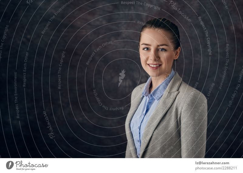Elegant woman standing against dark background Face Decoration Success Work and employment Business Company Career Woman Adults 1 Human being 18 - 30 years