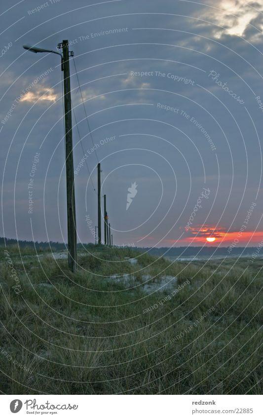 Sun Ocean Clouds Dark Meadow Grass Stone Lighting Hill Fence Beach dune Electricity pylon