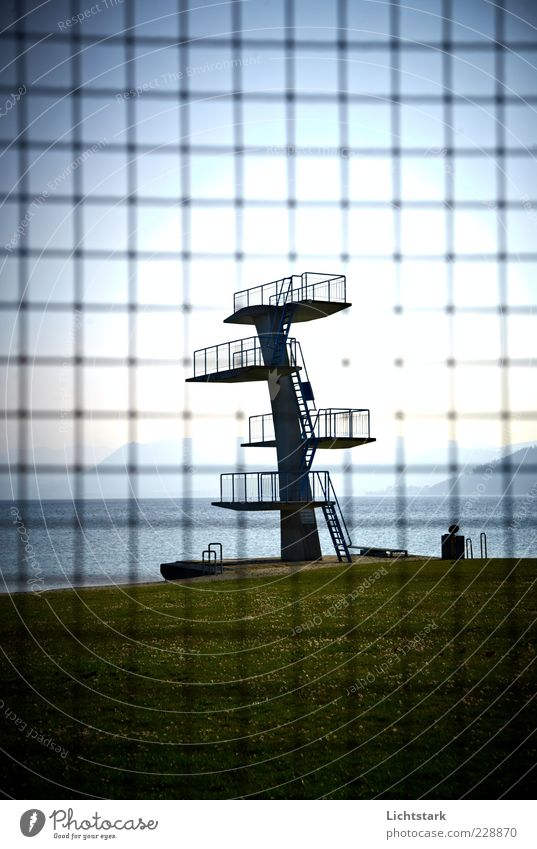 A day at the lake Sports Aquatics Swimming pool Mesh grid Concrete Metal Steel Rust Old Moody Climate Colour photo Exterior shot Deserted Day Light Shadow