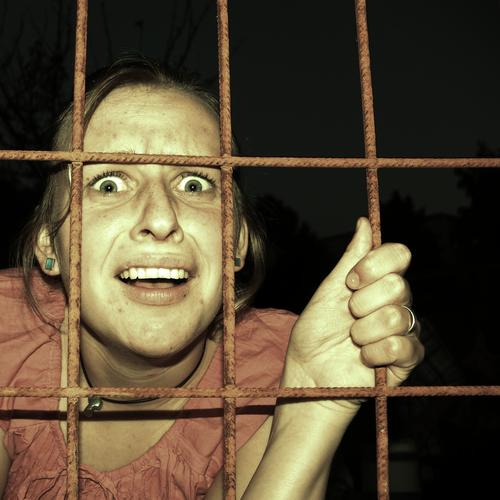 behind bars Young woman Youth (Young adults) 1 Human being To fall Fight Dark Fear Horror Fear of death Claustrophobia Distress Break taboo Sadness Captured