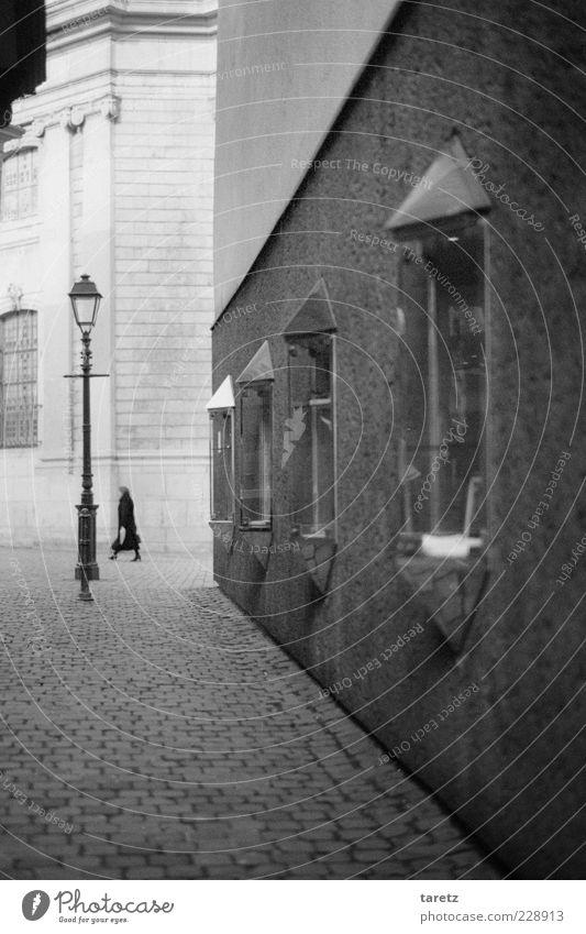 Human being Old Loneliness Adults Far-off places Wall (building) Wall (barrier) Elegant Esthetic To go for a walk Clean End Lantern 45 - 60 years Street lighting Cobblestones