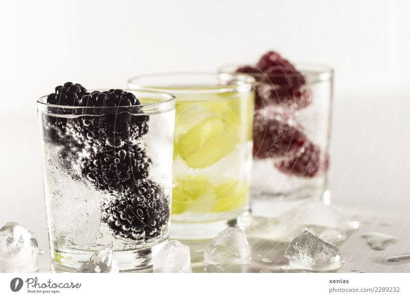 Three chilled thirst quenchers with fruit and mineral water. Blackberry, grape or raspberry Beverage Cold drink Ice cube Raspberry Bunch of grapes