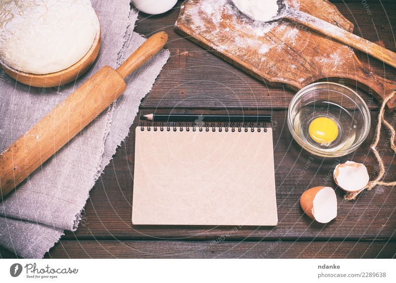 dough with ingredients on a brown wooden table Food Dough Baked goods Bread Bowl Spoon Table Kitchen Paper Wood Eating Fresh Natural Above Brown White Pencil