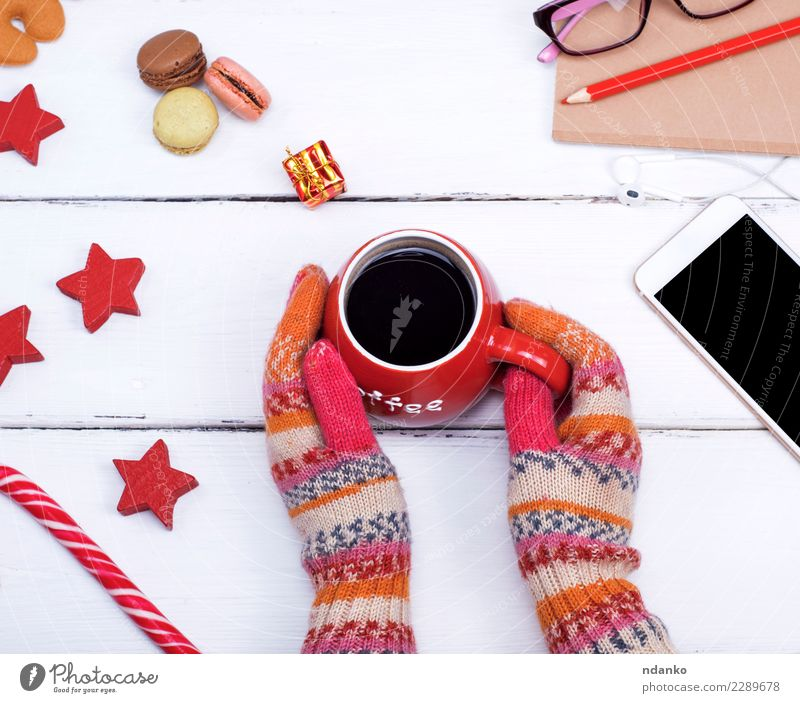 hands in knitted mittens hold a red cup Woman Christmas & Advent White Hand Red Relaxation Winter Adults Wood Food Feasts & Celebrations Above Body