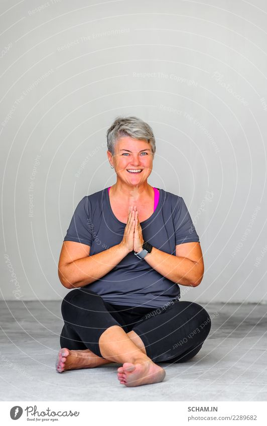 Yoga students showing different yoga poses. Sitting pose Lifestyle Relaxation Calm Meditation Human being Woman Adults 1 45 - 60 years Beautiful Uniqueness