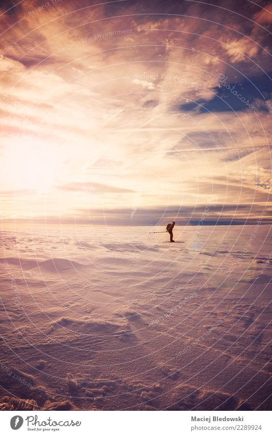 Winter landscape with cross-country skier silhouette at sunset. Relaxation Vacation & Travel Adventure Expedition Snow Winter vacation Mountain Sports Skis