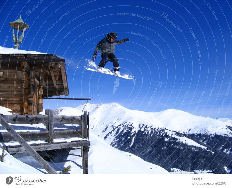 Jump Tall Large Roof Snowcapped peak Hut Brave Terrace Downward Snowscape Blue sky Snowboard Freestyle Zillertal Snowboarding Wooden hut
