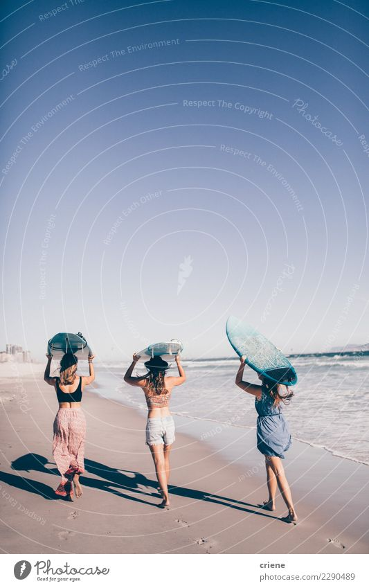 Group of friends going surfing in the ocean Woman Human being Vacation & Travel Summer Sun Ocean Joy Beach Adults Lifestyle Feminine Together Sand Friendship