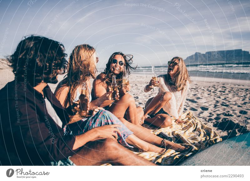 Group of friends having drinks on the beach in South Africa Drinking Beer Joy Happy Vacation & Travel Beach Party Friendship Sand Sunglasses Smiling Sit