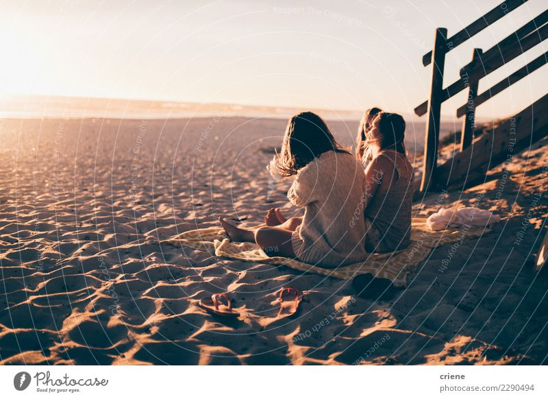 Group of friends sitting on the beach and enjoying sunset Happy Relaxation Leisure and hobbies Vacation & Travel Beach Party Feminine Friendship Sand Together