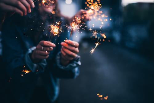Close-up of bright burning sparklers in the night Happy Entertainment Party Event Going out Feasts & Celebrations Dance Christmas & Advent New Year's Eve
