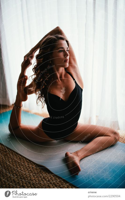 Healthy young adult woman doing yoga streching exercise Personal hygiene Wellness Calm Leisure and hobbies House (Residential Structure) Woman Adults