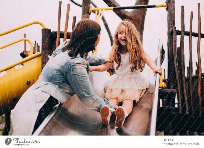 Mother and daughter having fun on playground together Joy Happy Playing Parents Adults Family & Relations Infancy Playground Together Emotions Daughter slide