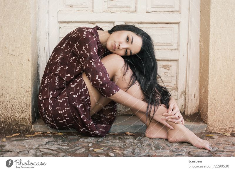 Woman sitting on the floor with her head resting on her knees Feminine Young woman Youth (Young adults) 1 Human being 18 - 30 years Adults Village Door Dress