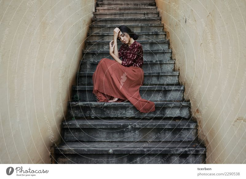 Portrait of melancholic woman sitting on symmetrical staircase Human being Youth (Young adults) Old Young woman Beautiful Loneliness Calm 18 - 30 years Adults