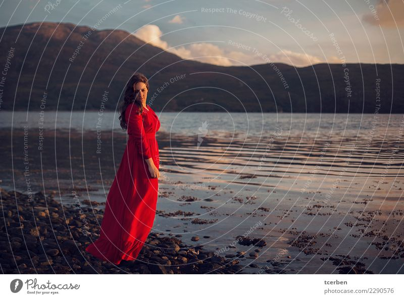Melancholic woman wearing a red dress on the seashore at sunset Woman Human being Sky Nature Youth (Young adults) Beautiful Water Landscape Red Loneliness Calm