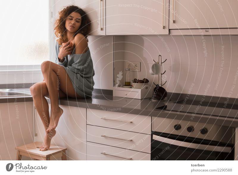 Portrait of brazilian woman sitting on the kitchen countertop Breakfast Lifestyle Feminine Young woman Youth (Young adults) 1 Human being 18 - 30 years Adults