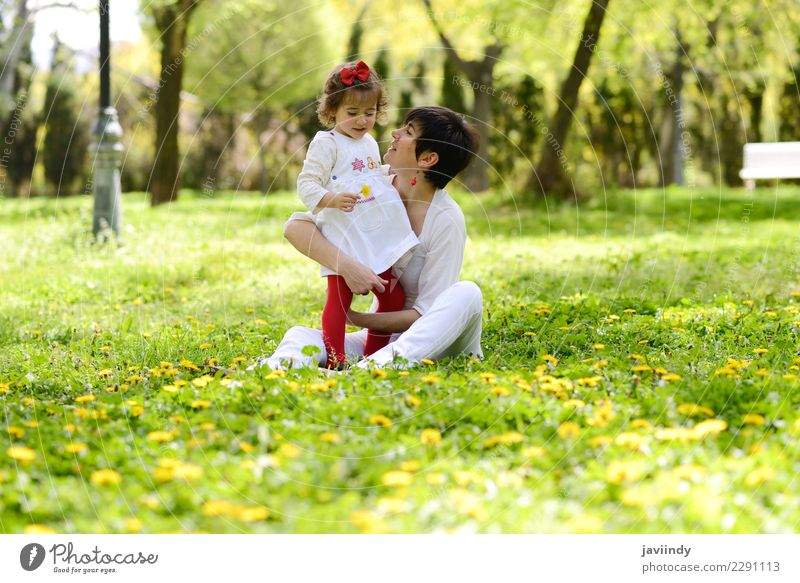 mother and little girl playing in the park Child Woman Human being Flower Joy Adults Lifestyle Love Emotions Feminine Grass Family & Relations Small Couple