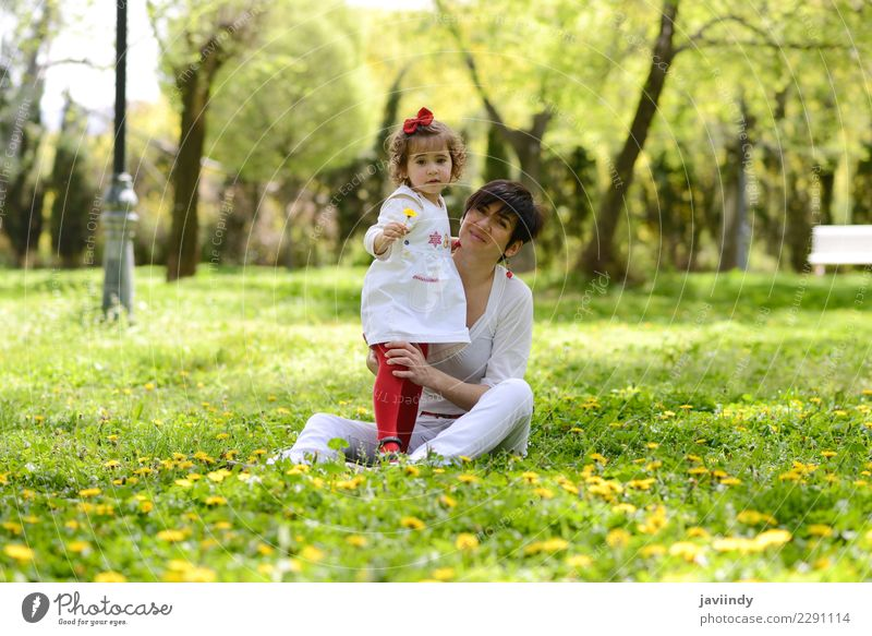 mother and little girl playing in the park Lifestyle Joy Child Human being Feminine Baby Girl Young woman Youth (Young adults) Woman Adults Mother