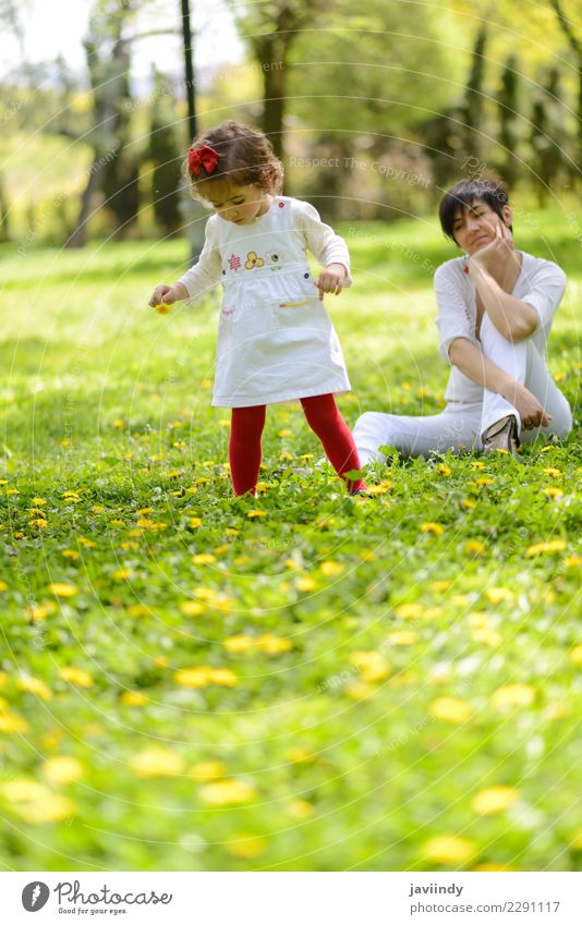 Mother and little girl playing in the park Lifestyle Joy Leisure and hobbies Garden Child Human being Feminine Baby Girl Woman Adults Family & Relations Infancy