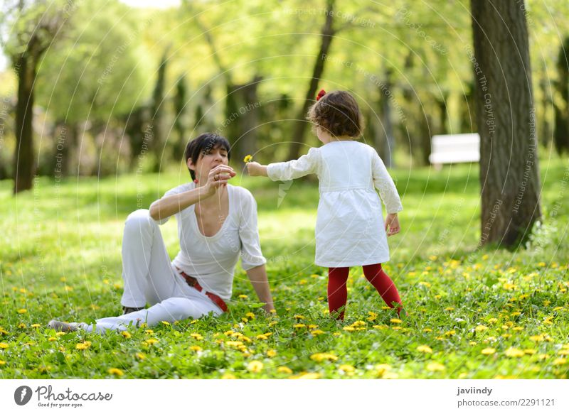 mother and little girl playing in the park Child Woman Human being Joy Girl Adults Lifestyle Love Emotions Grass Family & Relations Small Couple Together Park