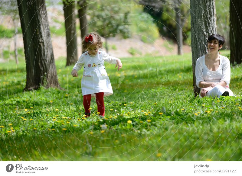 mother and little girl playing in the park Child Woman Human being Nature Joy Girl Adults Love Emotions Feminine Grass Family & Relations Couple Park Infancy