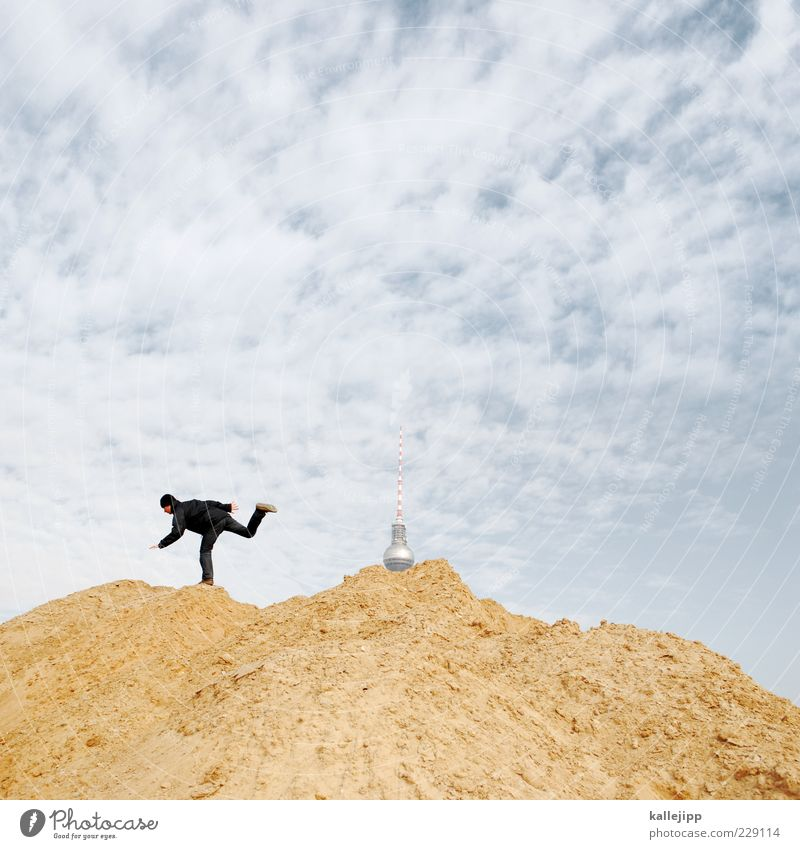 mud battle for dr. googleberg Construction site Human being Masculine Man Adults 1 Running Berlin Television tower Hip & trendy Clouds Sand Heap Colour photo