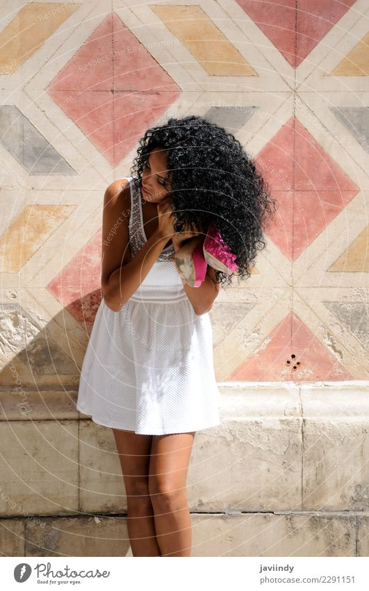 black woman, afro hairstyle, getting dressed in the street Woman Human being Youth (Young adults) Young woman Beautiful 18 - 30 years Black Face Adults