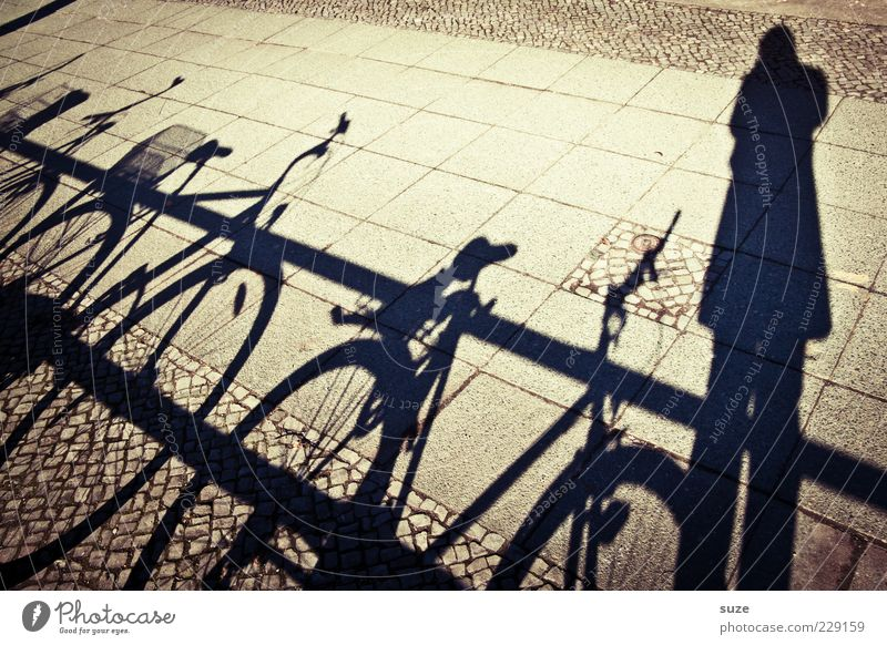 Human being Dark Bright Leisure and hobbies Bicycle Sidewalk Footpath Handrail Photographer Take a photo Shadow play Lanes & trails Shadow child