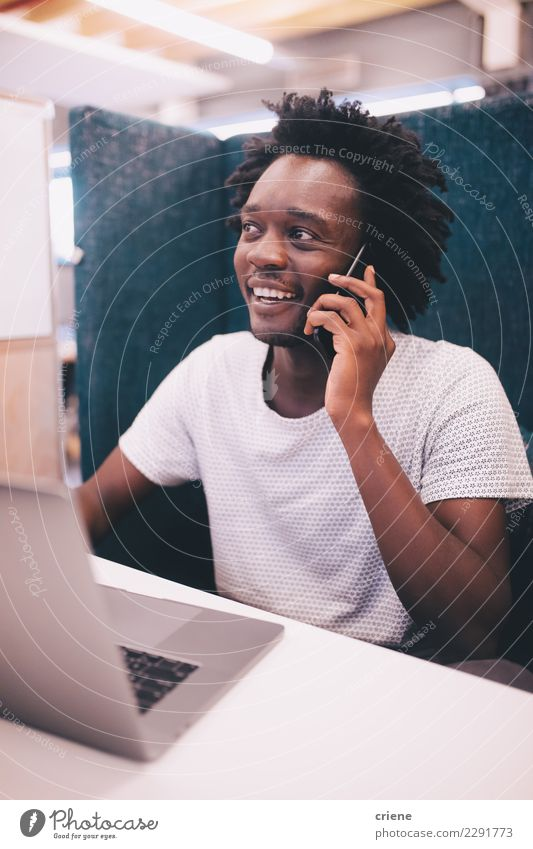 African American adult speaking on the phone at work Youth (Young adults) Man Adults To talk Happy Work and employment Office Technology Smiling Driving