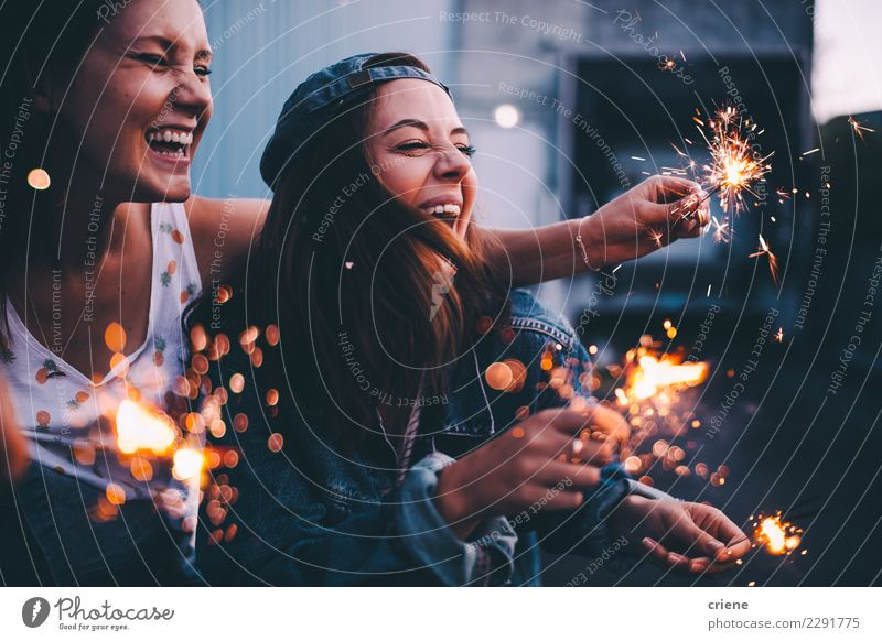 Young adult girlfriends celebrating with sparklers at night Happy Night life Entertainment Party Event Going out Feasts & Celebrations Dance Christmas & Advent