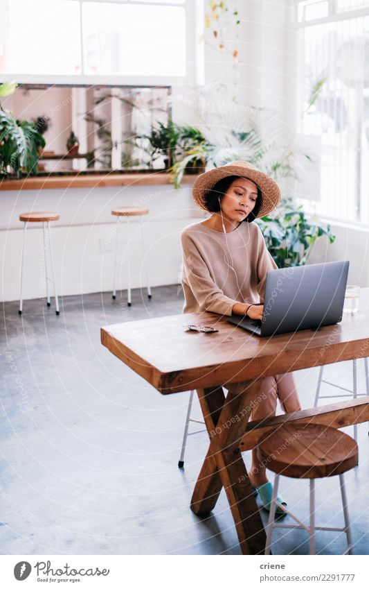 Young asian adult working on laptop in cafe Shopping Work and employment Financial Industry Business Computer Notebook Technology Woman Adults Email Communicate