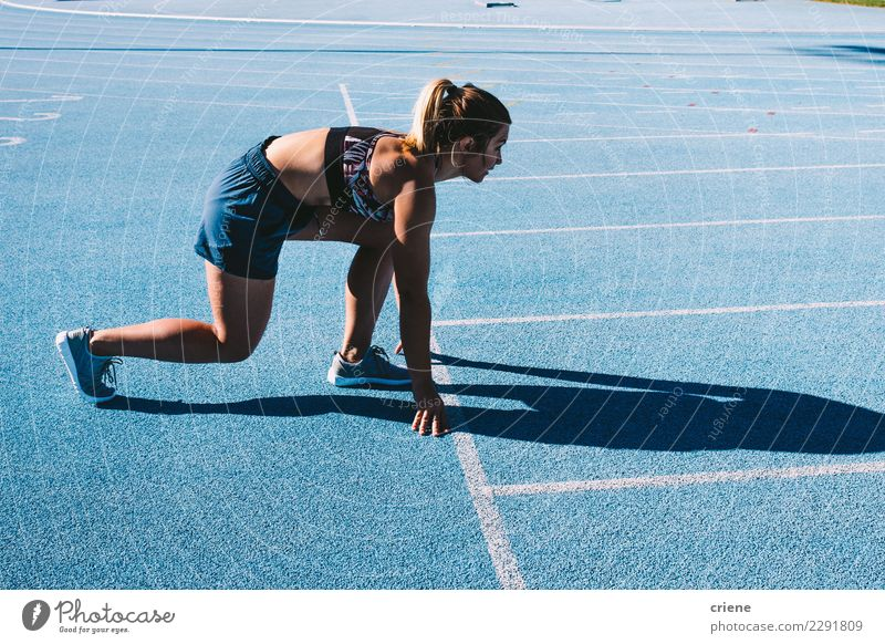 Fit female athlete sprinting on running track Sports Human being Feminine Woman Adults Fitness Speed Blue Beginning Practice Ready fast Finish line