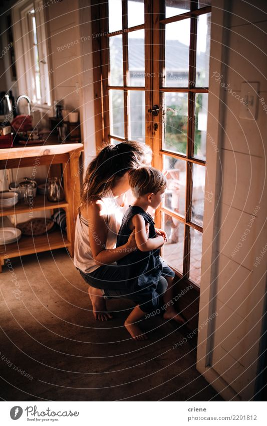 Mother and little boy looking out of the window together Happy Parents Adults Infancy Hut Wood Smiling Wait Together Modern Relationship Son door Home Strange