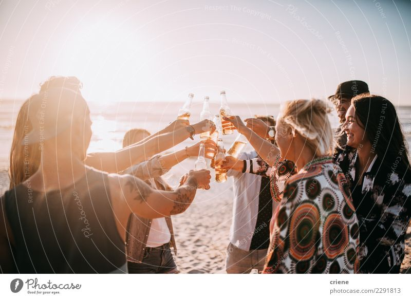 Group of young adult friends cheering with beers on beach Beverage Drinking Alcoholic drinks Beer Bottle Lifestyle Vacation & Travel Summer Beach Music