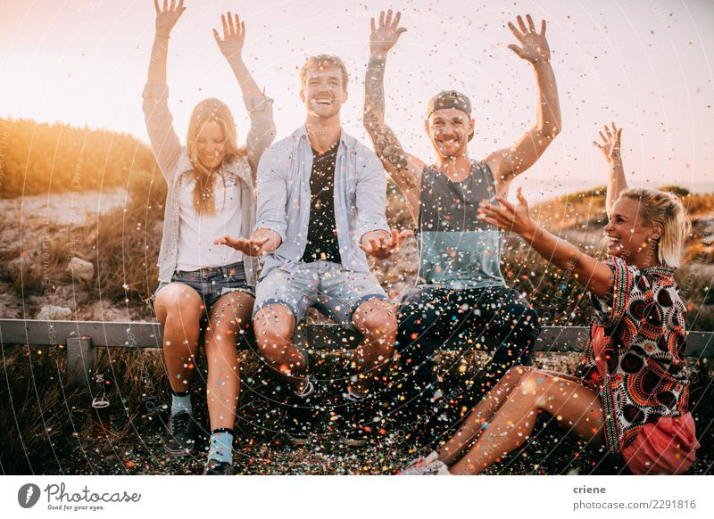Group of hipster friends cheering with confetti in sunset Happy Party Feasts & Celebrations Dance New Year's Eve Birthday Friendship Youth (Young adults)