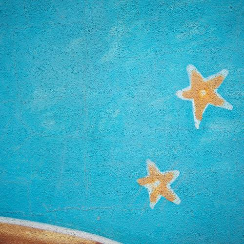 Star hour¹ Graffiti Blue Star (Symbol) Wall (building) Plaster Mural painting Starry sky Painted Colour photo Multicoloured Exterior shot Structures and shapes