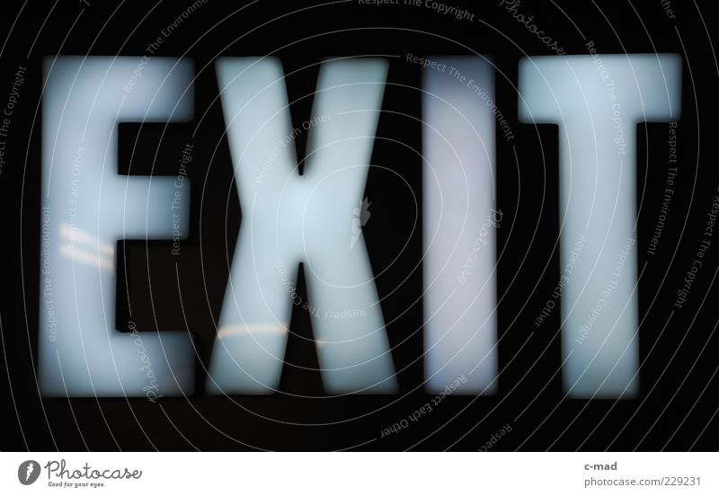 exit Signs and labeling Glass Plastic Characters Signage Warning sign Colour photo Interior shot Close-up Detail Deserted Neutral Background Artificial light